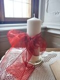 Decorative white candle on a stand Stock Photography