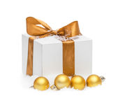 Decorative white gift box with a large gold bow Royalty Free Stock Photography