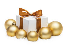 Decorative white gift box with a large gold bow Stock Photo