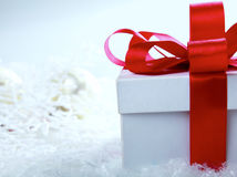 Decorative white gift box with a red bow a Royalty Free Stock Image