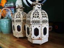 Decorative white metal lantern lamps on the table,vintage style Stock Photo