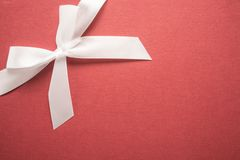 Decorative white ribbon and bow Stock Photo