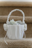 Decorative white silk basket with bow wedding Royalty Free Stock Photo