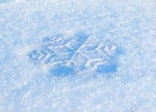 Snowflake. Decorative white snowflake on snow Royalty Free Stock Image