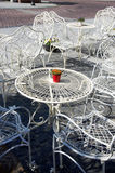 Decorative white tables and chairs outside cafe Royalty Free Stock Photography