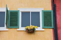 Decorative white window on an old orange stucco wall Stock Images