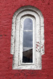 Decorative white window on an old red wall Stock Images