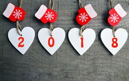 Free Decorative White Wooden Christmas Hearts And Red Mittens With 2018 Numbers On Wooden Background With Copy Space.Happy New Year 201 Stock Photo - 104332550