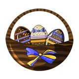 Decorative wicker basket  with chocolate eggs and beautiful bow isolated on white stock illustration