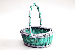 Decorative wicker basket made of wicker on a light background Stock Photography