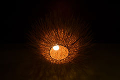 Decorative wicker lamp in dark room Stock Photo