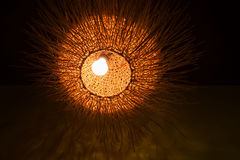 Decorative wicker lamp in dark room Royalty Free Stock Images