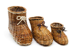 Decorative wicker shoes of the different sizes Royalty Free Stock Image
