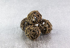 Decorative wicker wooden balls on a silver background stock image