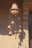 Decorative wind chime. A decorative ceramic wind chime with leaf design hanging from a sunlit doorway Stock Photography