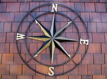 Decorative wind rose symbol. On brown wooden background Stock Photography
