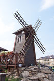 Decorative windmill - wood sculpture Stock Images