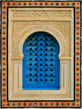 Decorative window. Beautifully decorated window in the Arab style, imitation entrance gate painted in traditional turquoise and metal protection Stock Image