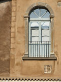 Decorative window on a brown wall Stock Photo
