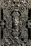 Decorative window metal door with a lion face stock photo