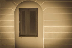 Decorative window vintage frame on old building stucco wall with Royalty Free Stock Photography