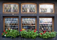 Decorative windows. With red and white flowers Stock Photos