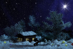 Decorative wood house with lights inside on black background. Rural Christmas night scene Royalty Free Stock Images
