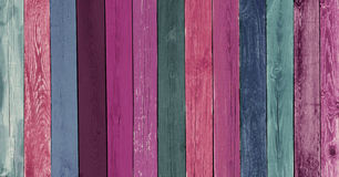 Decorative Wooden Background. Creative Colorful Wallpaper. Decorating Wood Panel of different Paint, Close-up. Restored old wooden Texture. Wide Horizontal Royalty Free Stock Images