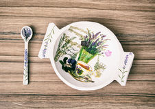 Decorative wooden bowl and spoon on the wooden background Stock Photos
