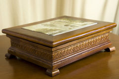 Decorative Wooden Box. Ornate, carved wooden box with painted tile insert Stock Images