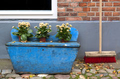 Decorative wooden box and a broom Stock Photo
