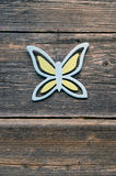 Decorative wooden butterfly on old farm wall Royalty Free Stock Images