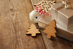 Decorative wooden christmas tree next to gift boxes Stock Photography