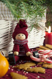 Decorative wooden doll on christmas background. Close-up. Stock Photos