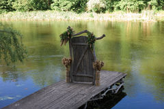 Decorative wooden door on a pier near the river Stock Photography