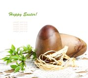 Decorative wooden Easter eggs with green branch Royalty Free Stock Photography