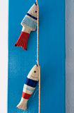 Decorative wooden fishes hanging by a rope Stock Image