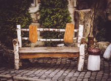 Decorative wooden garden bench. Decorations in rustic style Stock Photos
