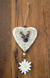 Decorative wooden heart with deer and edelweis flower Royalty Free Stock Image