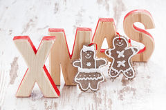Decorative wooden letters xmas on white background, gingerbread Stock Photos