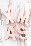 Decorative wooden letters xmas on a white background Royalty Free Stock Photos