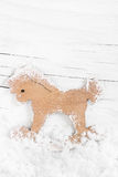 Decorative wooden little horse on snow wooden background. Royalty Free Stock Photos