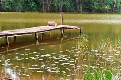 Wooden bridge over the river, decorative wooden path on the lake Stock Photo