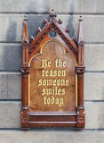 Decorative wooden sign - Be the reason someone smiles today Royalty Free Stock Image