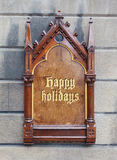Decorative wooden sign - Happy holidays Royalty Free Stock Image