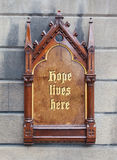 Decorative wooden sign - Hope lives here Stock Photo