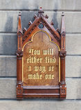 Decorative wooden sign - You will either find a way or make one. Decorative wooden sign hanging on a concrete wall - You will either find a way or make one Stock Photos