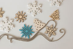Decorative wooden snowflakes and a Christmas tree with a string Stock Image