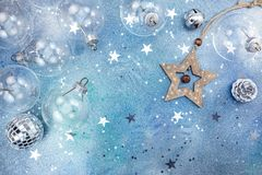 Decorative wooden star and glass christmas balls on blue backgro Royalty Free Stock Image