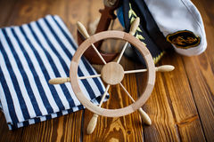 Decorative wooden steering wheel. On an old wooden table Stock Images